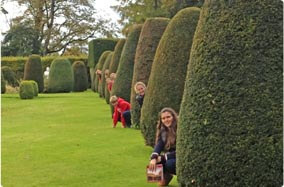 Family fun in the formal gardens at Drummond Castle